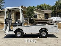 Used Taylor Dunn B2-48 Industrial Flatbed Electric Utility Cart New Motor